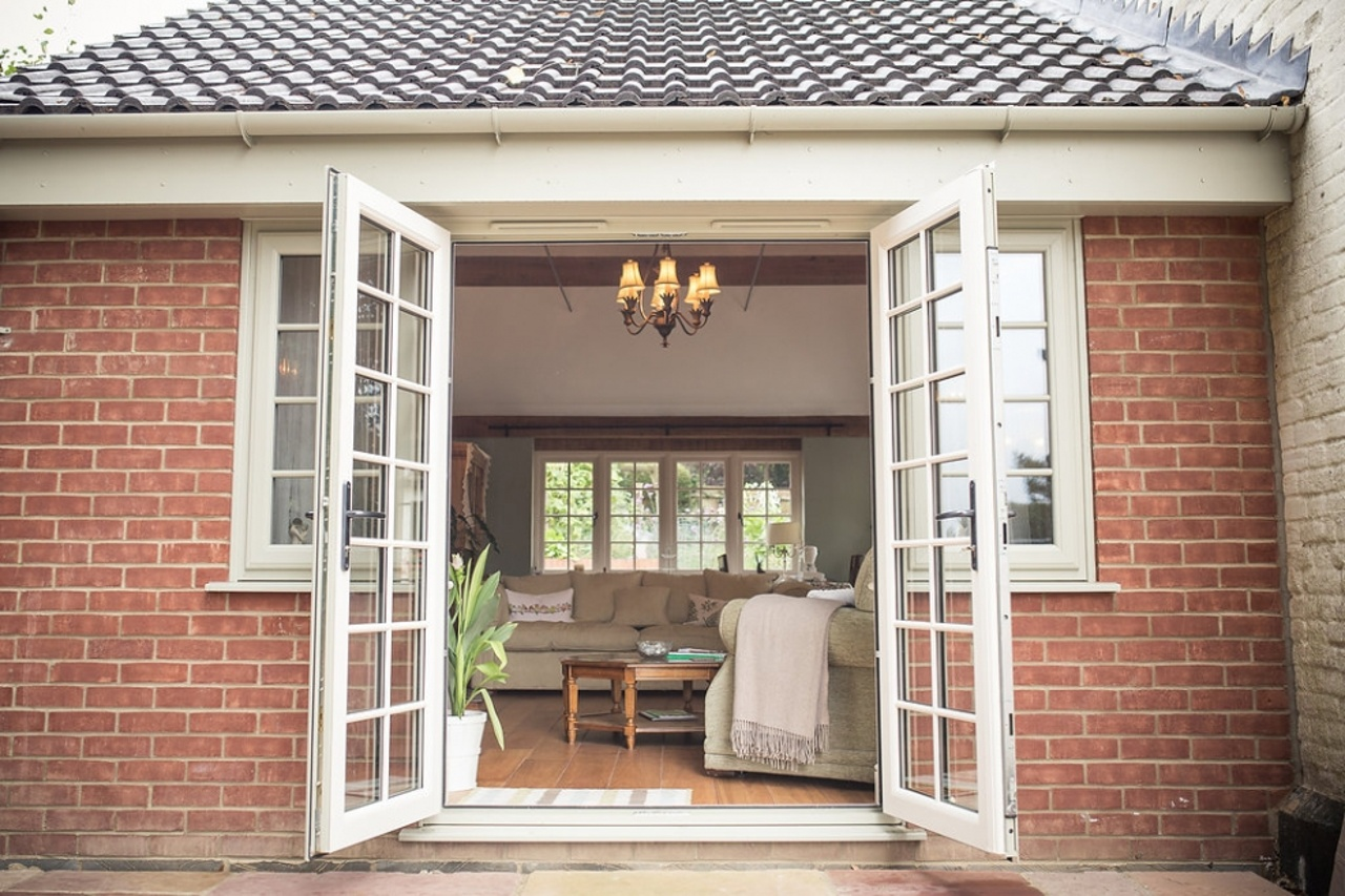 Garden Room with Exposed Beams and French Windows